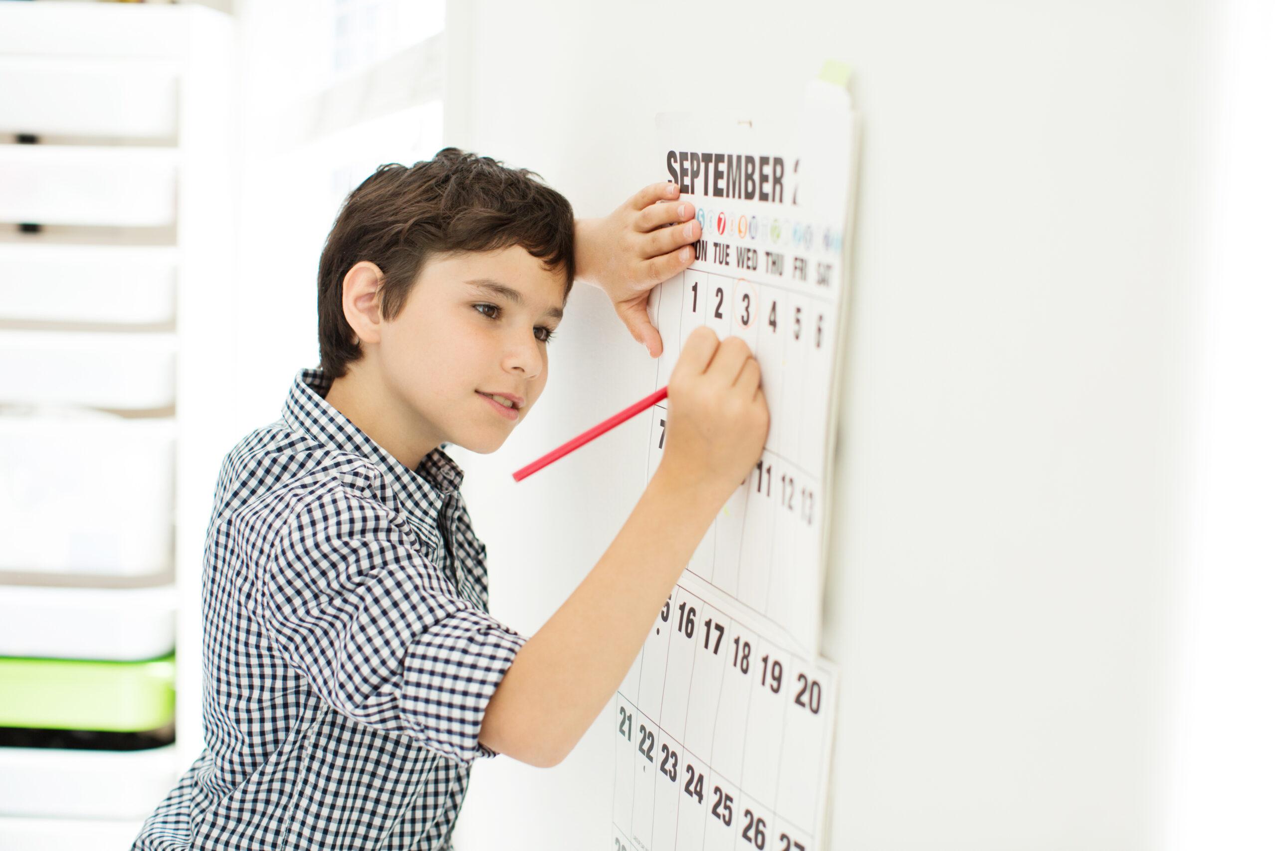 Student writing on Calendar